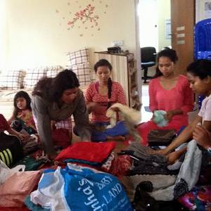 Preparing clothes and food for the people in the Gorkha district